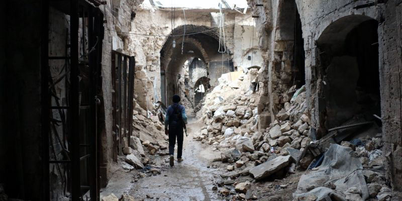 A rebel fighter walks in a devastated alley of Aleppo's old market, in the UNESCO-listed northern Syrian city on February 27, 2014. Some 3,300 people have been killed in fighting between rebels seeking President Bashar al-Assad's ouster and their erstwhile jihadist allies since clashes erupted in January, a monitoring group said on february 26, 2014. AFP PHOTO / AMC / ZEIN AL-RIFAI (Photo credit should read ZEIN AL-RIFAI/AFP/Getty Images)